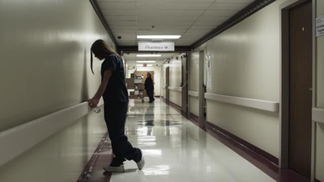 WS Woman waiting in hospital corridor / Payson, Utah, USA