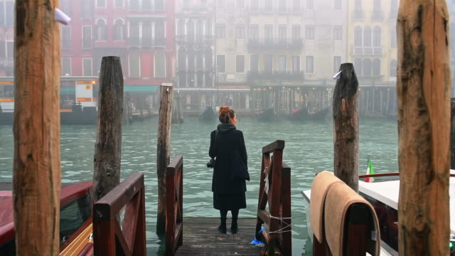 woman waiting on pier - venice italy stock videos & royalty-free footage