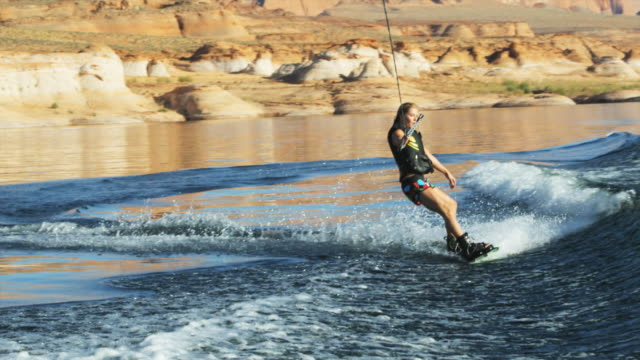 woman wakeboarding - wakeboarding stock videos and b-roll footage