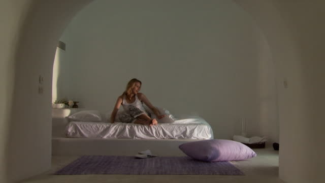 a woman waking up and leaving her bedroom - see other clips from this shoot 1144 stock videos & royalty-free footage