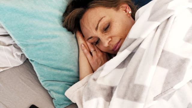 woman waking up fresh - soft blanket stock videos and b-roll footage