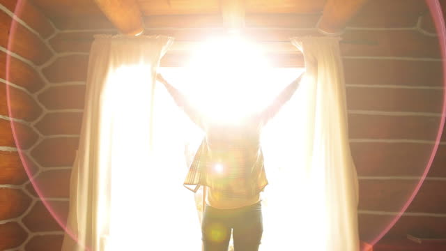 woman waking up in a beautiful sunny morning. - brightly lit stock videos and b-roll footage