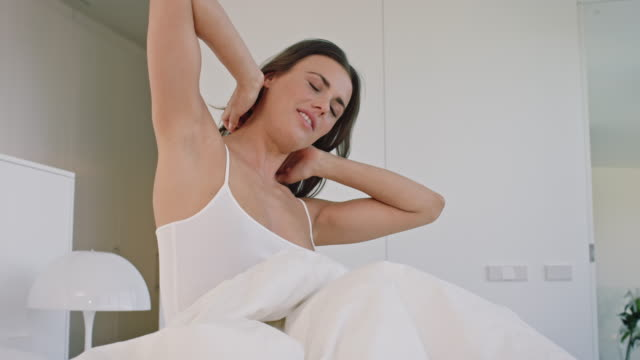 woman waking up - waking up stock videos & royalty-free footage