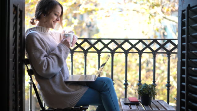 woman waking up with cup of coffee at the terrace - balcony stock videos & royalty-free footage