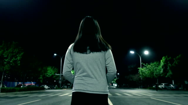 woman walking alone at night street - underpass stock videos and b-roll footage