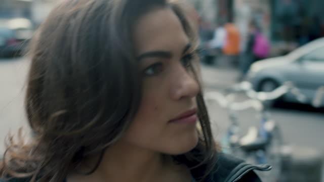 woman walking along busy street - beautiful woman stock videos & royalty-free footage
