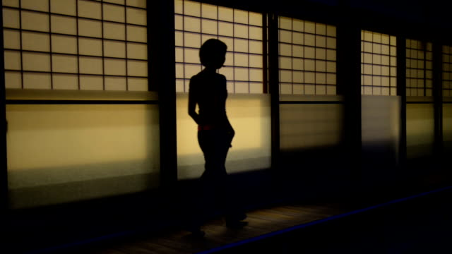 woman walking along dark street - screen partition stock videos and b-roll footage