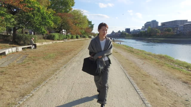 woman walking along the river - walking point of view stock videos & royalty-free footage
