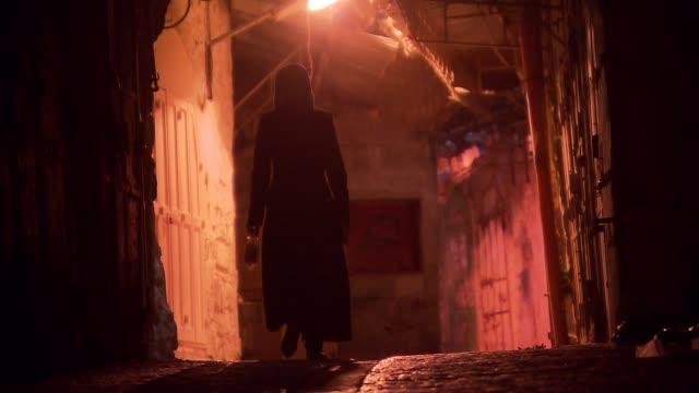 woman walking along the street of old town jerusalem - jerusalem stock videos & royalty-free footage