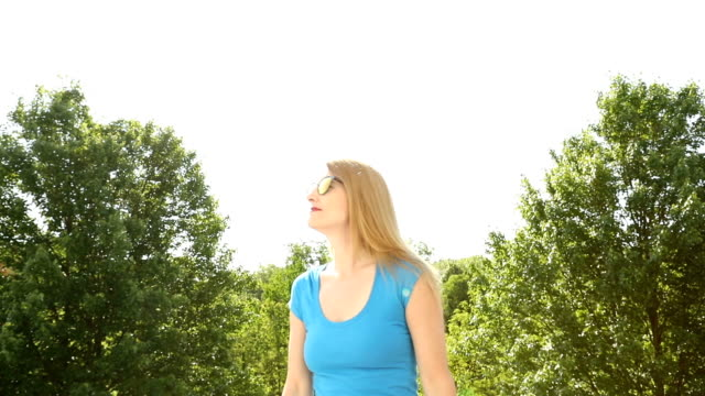 woman walking and enjoying spring day - 45 49 anni video stock e b–roll