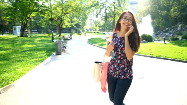 Woman walking and having telephone conversation