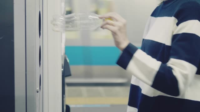 woman walking and throwing garbage to a trash bin - water bottle stock videos & royalty-free footage