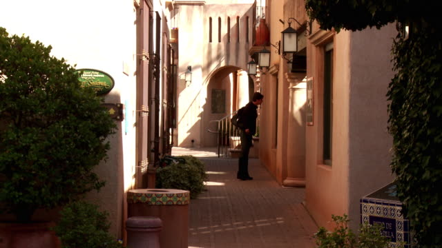 MS Woman walking and window shopping on narrow street, Sedona,  Arizona, USA