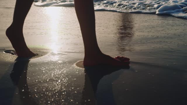woman walking at beach - sabbia video stock e b–roll