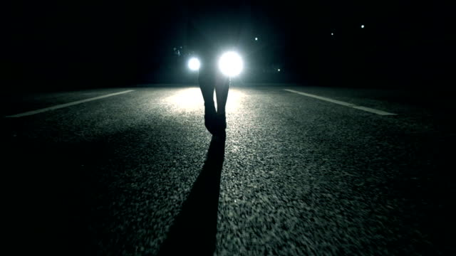 woman walking at night in front of car light - femininity stock videos & royalty-free footage