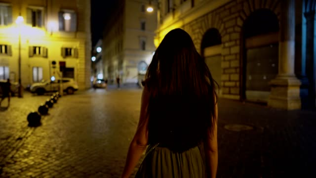 woman walking at the streets of rome by night - rome italy video stock e b–roll