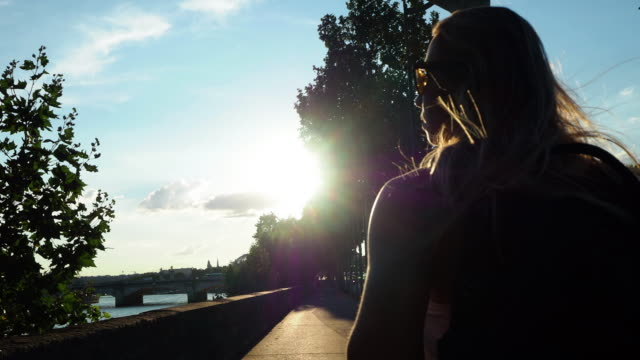 woman walking by the river in paris - seine river stock videos & royalty-free footage