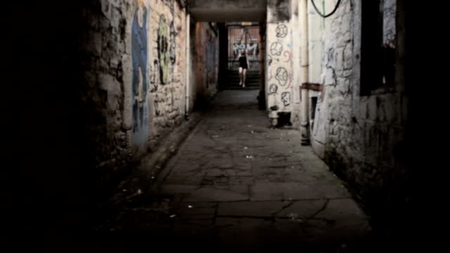 woman walking down dirty alley - temptation stock videos & royalty-free footage