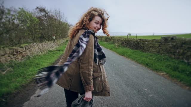 Woman Walking Down English Country Lane
