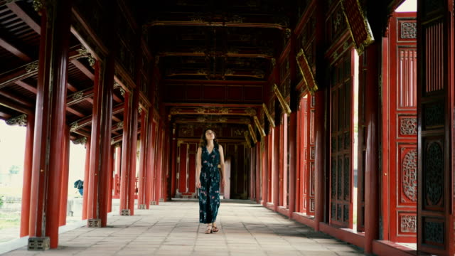 woman walking in ancient chinese imperial city - vietnam stock videos & royalty-free footage