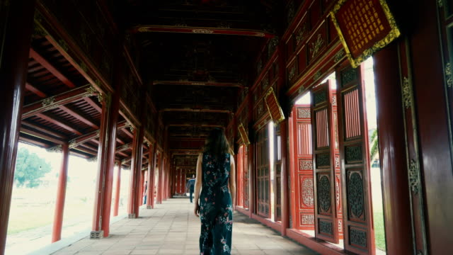 woman walking in ancient chinese imperial city - tradition stock videos & royalty-free footage