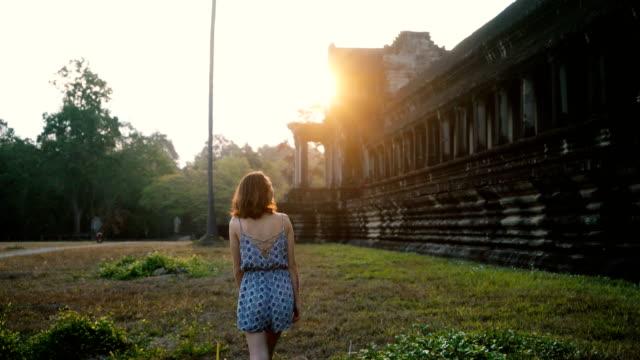 woman walking  in  angkor wat - cambodia stock videos & royalty-free footage