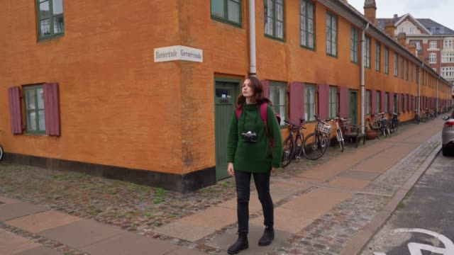 woman walking in copenhagen - curiosity stock videos & royalty-free footage