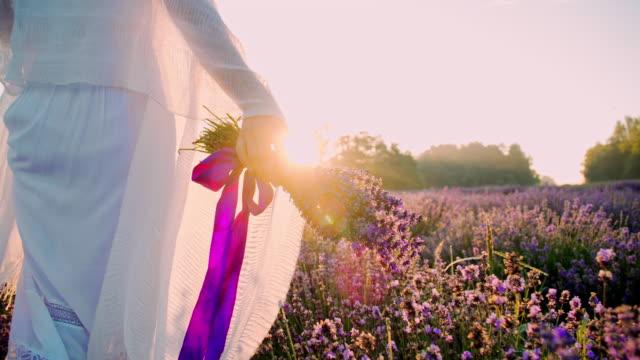 cu woman walking in field of lavender - shawl stock videos & royalty-free footage