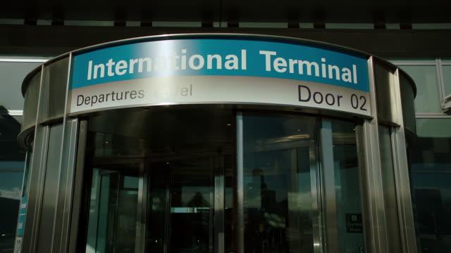 ms woman walking in intl terminal entrance - san francisco international airport stock videos & royalty-free footage