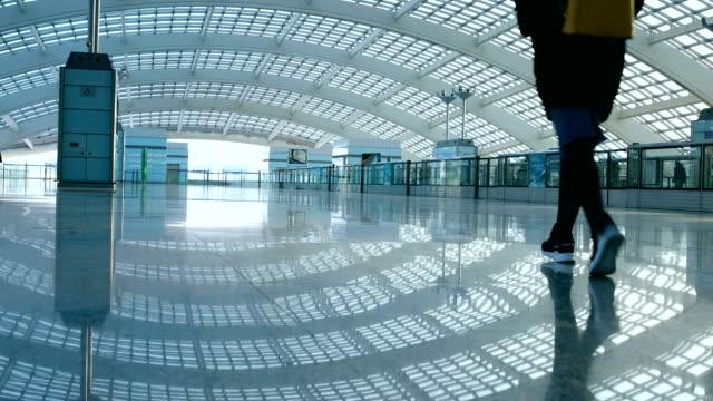 woman walking in modern station