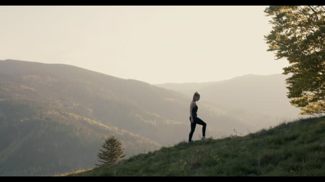 woman walking in nature barefoot - gesunder lebensstil stock-videos und b-roll-filmmaterial