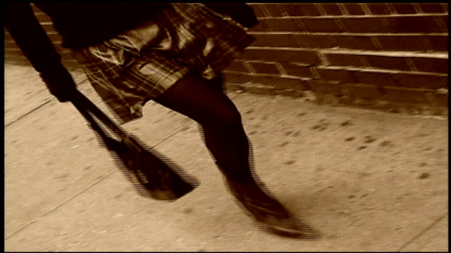 woman walking in red boots and plaid skirt with sepia filter in nyc - plaid stock videos & royalty-free footage