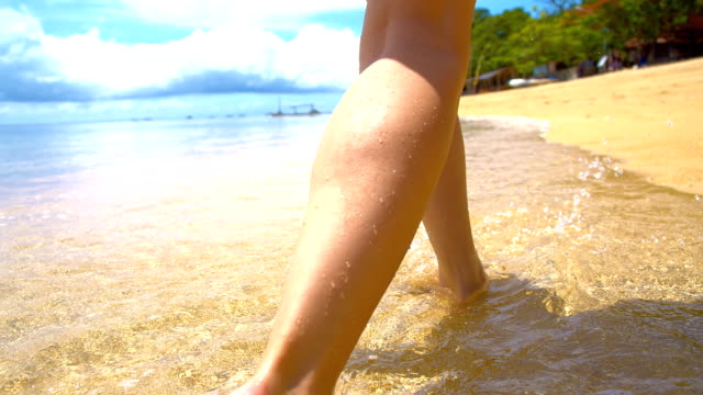 SLO MO Woman Walking In Shallow Water