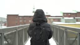 Woman walking in Snowy Weather