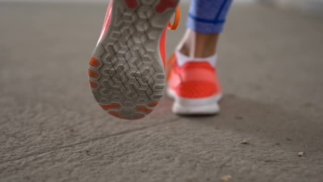 woman walking in sport shoes - footwear stock videos & royalty-free footage