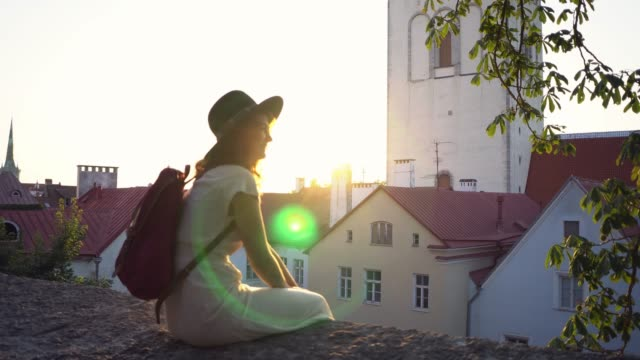 woman walking in tallinn in the morning - old town stock videos & royalty-free footage