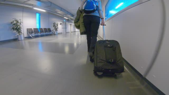 LA Woman walking in the airport in Oslo