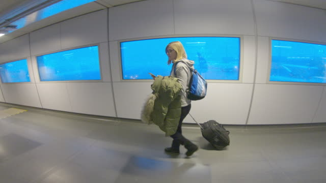 WS Woman walking in the airport
