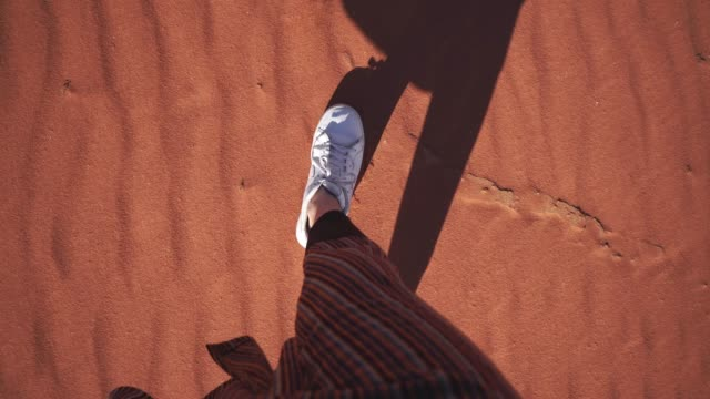 woman walking in  wadi rum desert. personal perspective - shoe stock videos & royalty-free footage