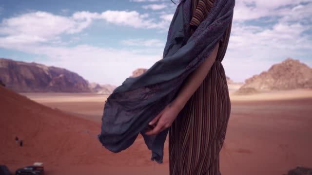 woman walking in wadi rum desert - stand stock videos & royalty-free footage