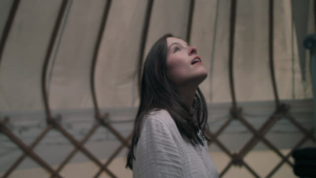 woman walking in yurt in morning - looking up stock videos & royalty-free footage