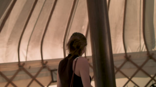 Woman walking in yurt
