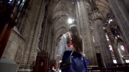 Woman walking inside the Milan Cathedral
