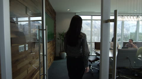 woman walking into conference room. - brown hair stock videos & royalty-free footage