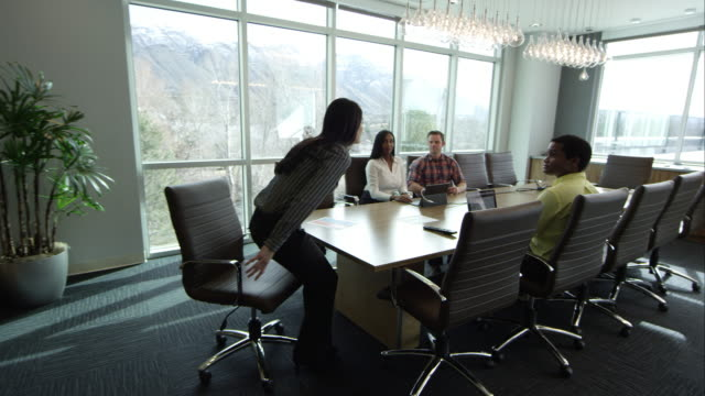 woman walking into conference room. - room 2015 film stock videos and b-roll footage