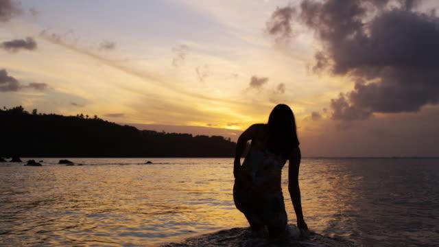 woman walking into the ocean - walking in water stock videos & royalty-free footage