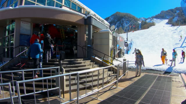 woman walking next to cable car, aspen, colorado - ski resort stock videos & royalty-free footage