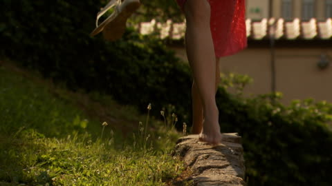 a woman walking on a low brick wall - see other clips from this shoot 1150 stock videos & royalty-free footage
