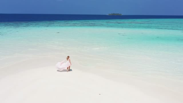 woman walking on a sandbank in maldives - turquoise coloured stock videos & royalty-free footage