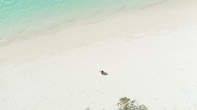 a woman walking on a white sand beach in australia - caucasian ethnicity stock videos & royalty-free footage